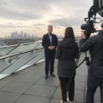 Chris MacNeil from Brexit Help filming outside London's Living Room, City Hall, Southwark